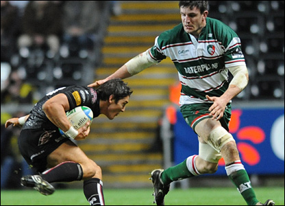 The long arm of visting skipper Martin Corry's law reaches out to James Hook as the Ospreys and Tigers do battle at Liberty Stadium on Saturday