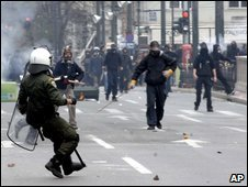 Riot police clash with rioters in central Athens, 24 January