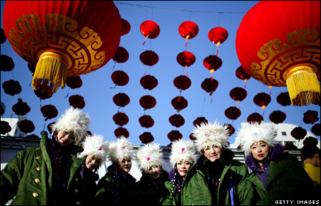 Performers pose for pictures at the Ditan Temple Fair in Beijing, China
