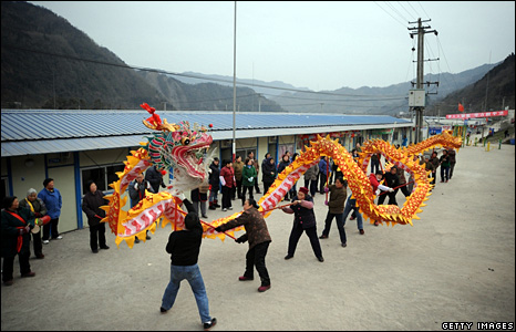 People from the earthquake-hit province of Sichuan practise a dragon dance at the Hongbai Township