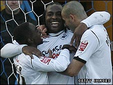 Jason Scotland (centre) scored Swansea's second goal against Portsmouth