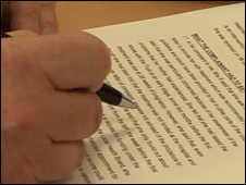 Man underlining words on a report