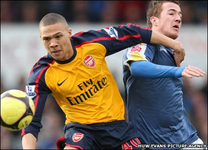 Cardiff City's Ross McCormack gets it in the throat from Arsenal's Kieron Gibbs