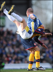 Cardiff's Gabor Gypes lands on Robin Van Persie as the Bluebirds and Gunners play out their 0-0 draw at Ninian Park