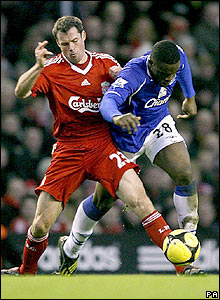 Jamie Carragher is called into action to deal with Everton's Victor Anichebe