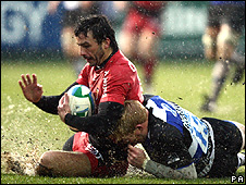 Toulouse's Clement Poitrenaud is tackled by Alex Crockett