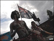 Aborigine with Australia flag, march by indigenous war veterans, Sydney April 08