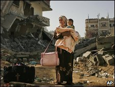 A Palestinian woman and her child