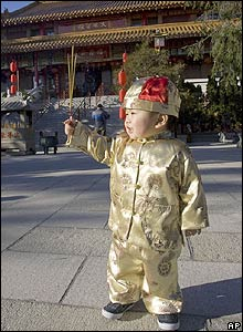 Ian Leong holds incense sticks at a Buddhist temple in Richmond, British Colombia, Canada on 25/1/09