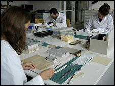 Technicians at work in Auschwitz conservation laboratory