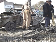 Pakistani police officers examine the site of bomb explosion in Dera Ismail Khan, Pakistan on Monday, Jan. 26, 2009.