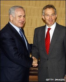 Binyamin Netanyahu shakes hands with Tony Blair at Sunday's meeting