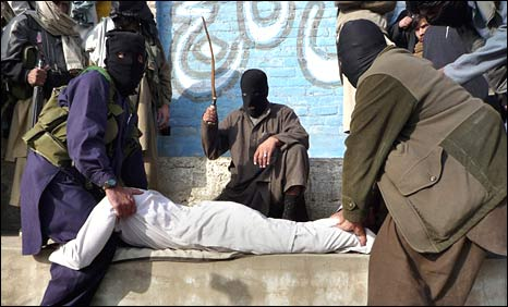 Masked Taleban militants publicly flog an alleged drug smuggler in Dheri, near Mingora, Sunday January 11, 2009