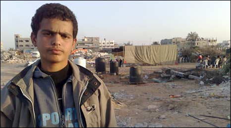 Ahmed stands next to the rubble of his destroyed house in Gaza City