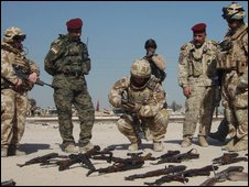 Iraqis and British mentors inspect weapons