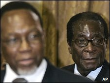 Robert Mugabe, right, walks behind Kgalema Motlanthe before the talks in Pretoria, South Africa, 26 January 2009
