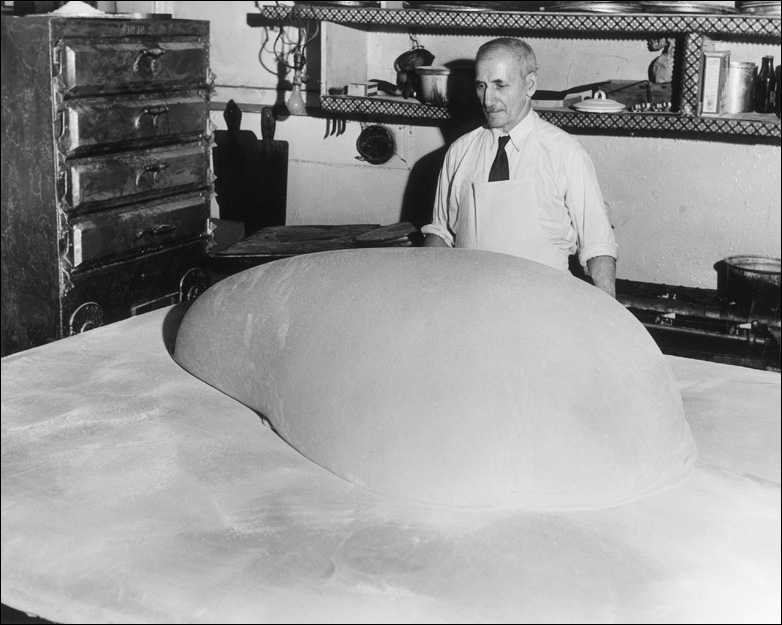 A baker prepares a large piece of dough to be used for making Baklava, New York City