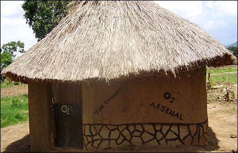 "A hut in Uganda decorated with the slogans ""The Gunners"" and ""Arsenal"" (Photo: BBC News website reader Moses Rubn Omilia)"