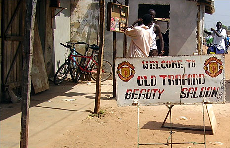 "A sign reading ""Welcome to the Old Trafford Beauty Saloon"" in The Gambia. (Photo: Stella Joseph, in Brikama, Gambia (Photo: BBC News website reader Stella Joseph)"