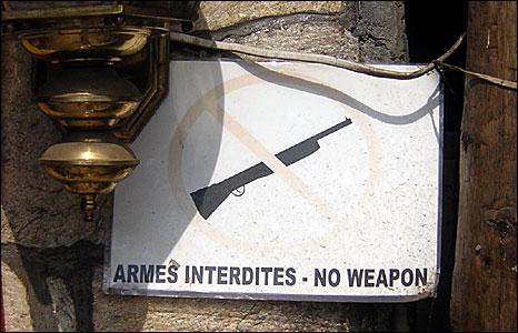 "A sign outside a Congolese bar saying, ""No weapons"" (Photo: BBC News website reader Edward Roberts)"