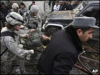 An injured US soldier is stretchered away after a bomb attack in Kabul, 17 January