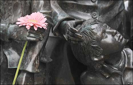 A flower at a memorial to Jews who perished in the Holocaust, near Berlin's Friedrichstrasse railway
