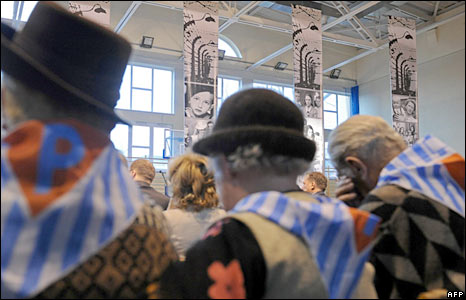 Former Auschwitz-Birkenau death camp prisoners take part in a remembrance ceremony in Poland
