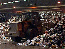 Preparing piles of rubbish for recycling (Image: BBC)