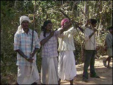 Proteters in Orissa carrying bows and arrows