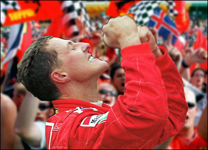 Michael Schumacher celebrates winning the drivers' title at the Japanese Grand Prix in 2000