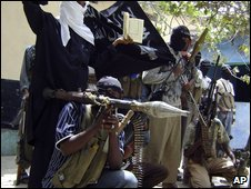 Islamist fighters pose with their equipment in a Mogadishu football stadium on 16 January 2009