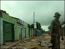 A government soldier stands in a ruined street in Mullaitivu, northern Sri Lanka, 27 January