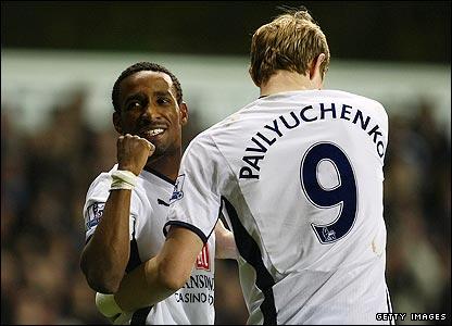 Tottenham's Roman Pavlyuchenko congratulates team-mate Jermain Defoe