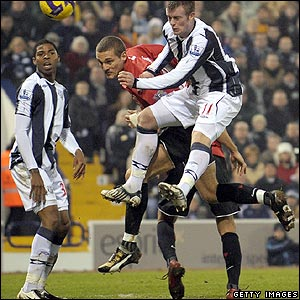 Nemanja Vidic glances Ryan Giggs's corner into the West Brom net