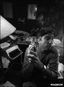 John Updike in his study