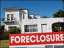 A foreclosure sign stands in front of a home in Miami Beach, Florida, 22 January 2009