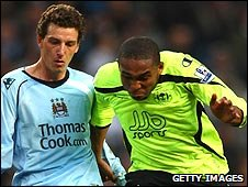 Palacios (right) in action for Wigan against Manchester Citwilson y