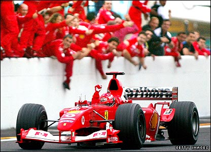 Michael Schumacher crosses the line in eighth place at the 2003 Japanese Grand Prix