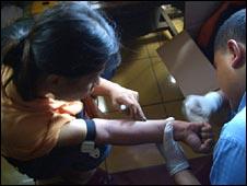 Drug user takes a blood test for HIV virus on 28 January 2009, in Kampung Boncos, west Jakarta
