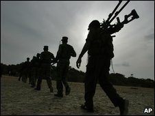 Tamil Tiger fighters rehearse to break through outer defense lines of a military camp at a training camp in the north east of Colombo, Sri Lanka, July 2007