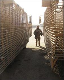 Sgt Maj Jim Leach between two British Mastiff armoured vehicles