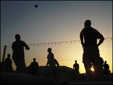 British soldiers play volleyball at Basra's naval base