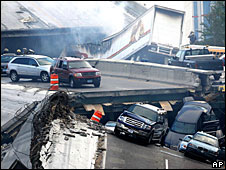 Vehicles on the collapsed I-35W bridge in Minnesota, 1 August 2007 (Picture courtesy of the Minnesota Daily)