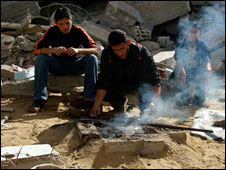 Men cooking over open fire