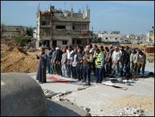 Prayers held on ground near the mosque