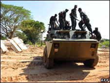 Soldiers on top of Sri Lankan Army APC