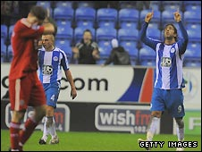 Mido kept his composure to level the scores for Wigan