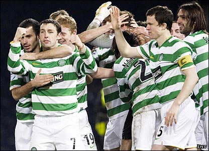 Scott McDonald (second left) scores the winning penalty and is congratulated by his team-mates