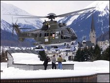 A Super Puma helicopter from the Swiss army leaves the roof of the Davos
