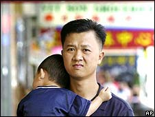 An Asian man walks with a small child in Sydney's Chinatown district (file photo)